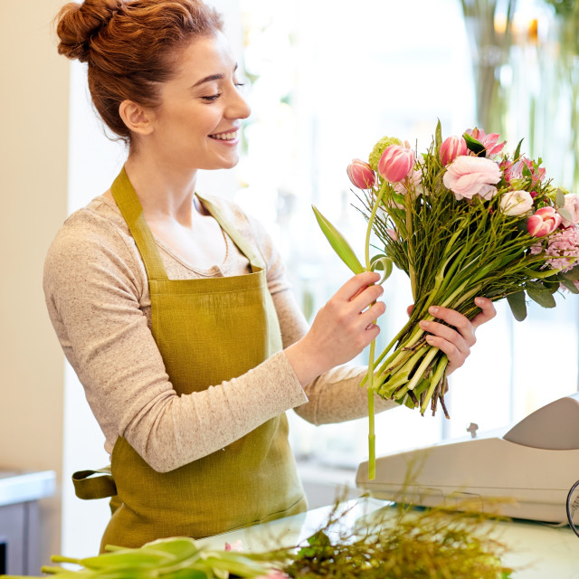 """""""smiling florist woman making bunch at flower shop"""" stock image"""