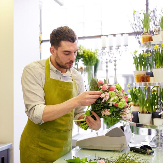 """florist man making bunch at flower shop"" stock image"