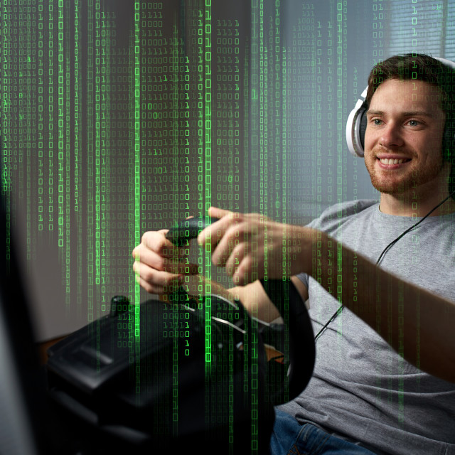 """man playing car racing video game at home"" stock image"