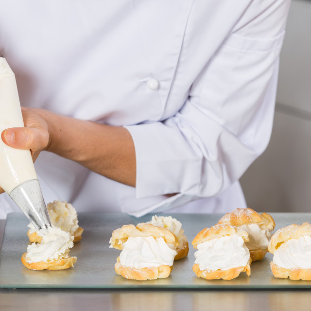 """""""Pastry chef decorating"""" stock image"""