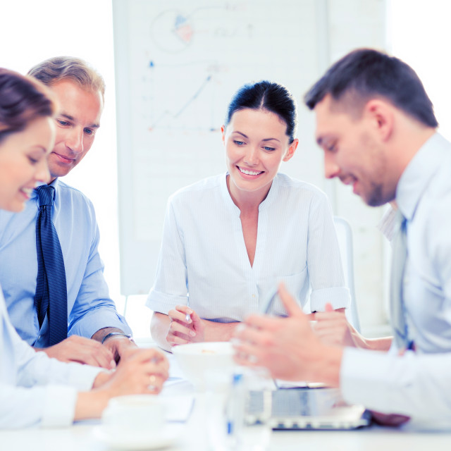 """""""business team having meeting in office"""" stock image"""