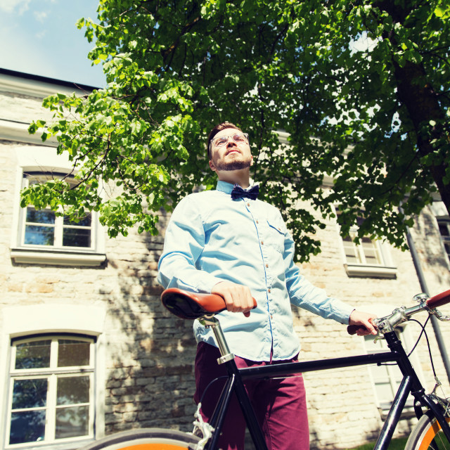 """""""happy young hipster man riding fixed gear bike"""" stock image"""