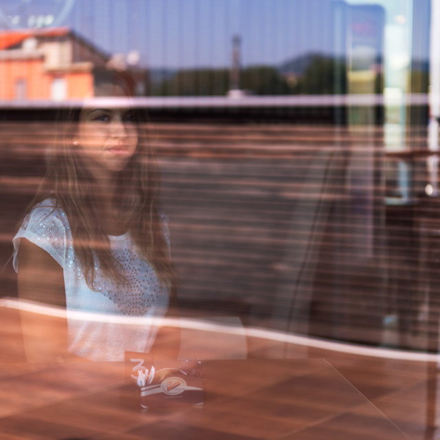"""""""Thoughts behind a window"""" stock image"""