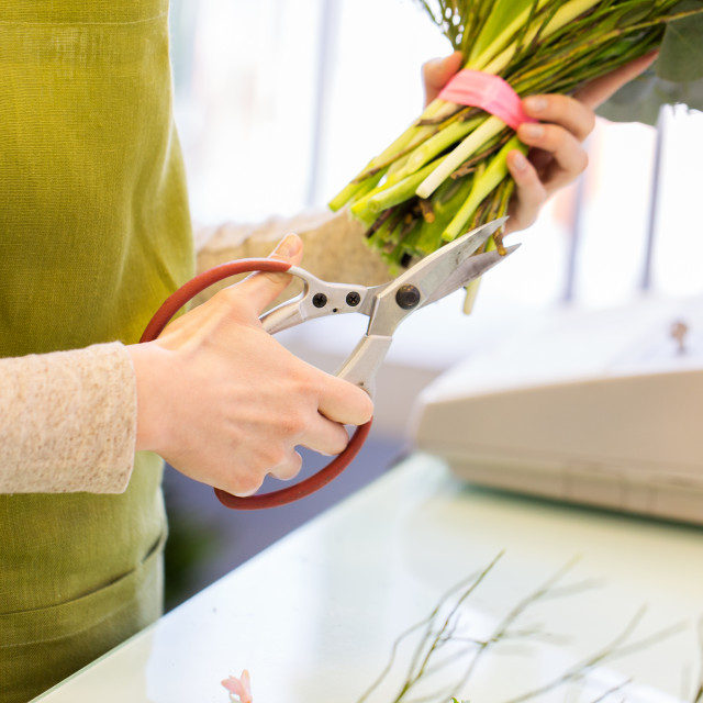 """""""close up of florist making bunch at flower shop"""" stock image"""