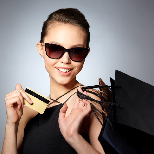 """""""happy woman with credit card and shopping bags"""" stock image"""