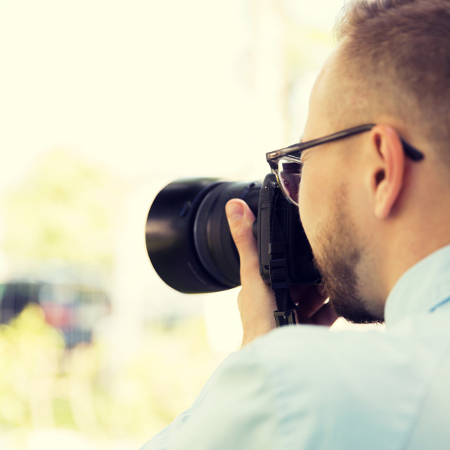 """close up of male photographer with digital camera"" stock image"