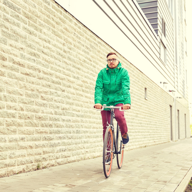 """""""young hipster man riding fixed gear bike"""" stock image"""