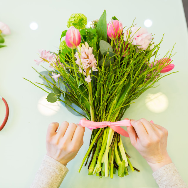 """""""close up of woman making bunch at flower shop"""" stock image"""