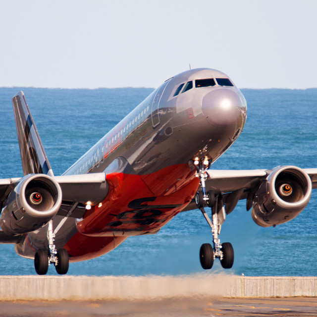 """""""JETSTAR A320 CLIMBING OUT AT WELLINGTON AIRPORT"""" stock image"""
