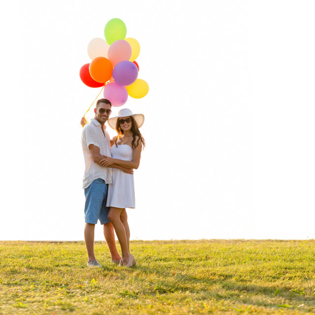 """""""smiling couple with air balloons outdoors"""" stock image"""