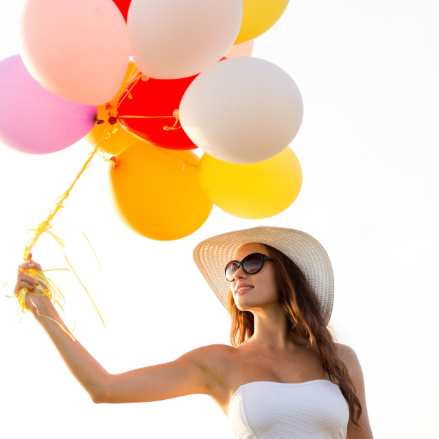 """""""smiling young woman in sunglasses with balloons"""" stock image"""