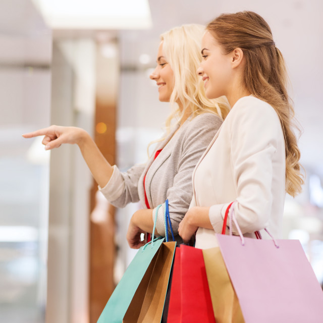 """""""happy young women with shopping bags in mall"""" stock image"""