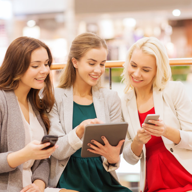 """""""happy women with smartphones and tablet pc in mall"""" stock image"""