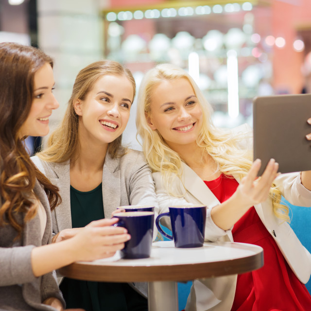 """""""smiling young women with cups and tablet pc"""" stock image"""