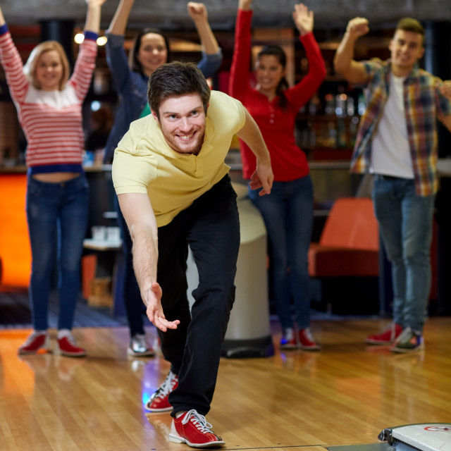 """""""happy young man throwing ball in bowling club"""" stock image"""