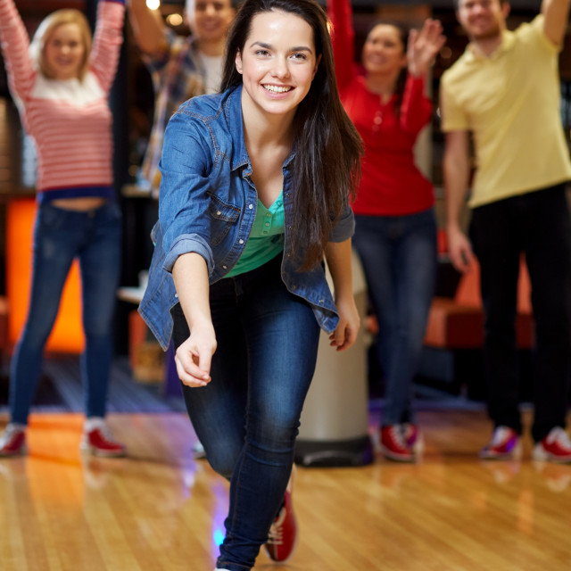 """""""happy young woman throwing ball in bowling club"""" stock image"""