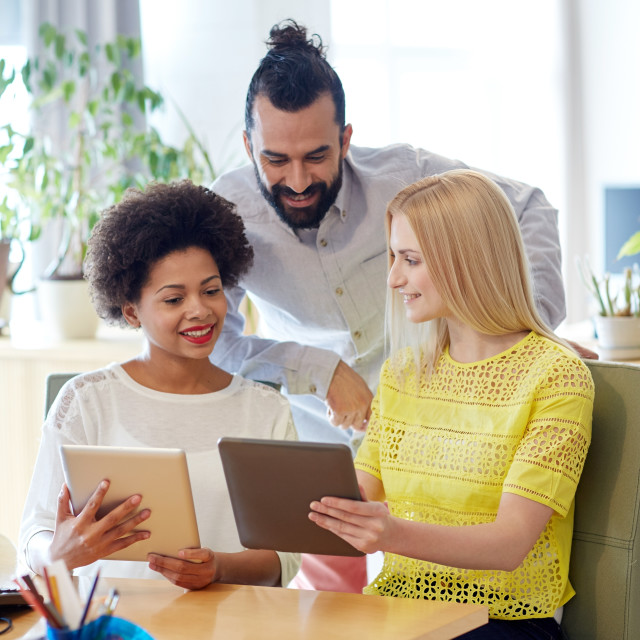 """""""happy creative team with tablet pc in office"""" stock image"""