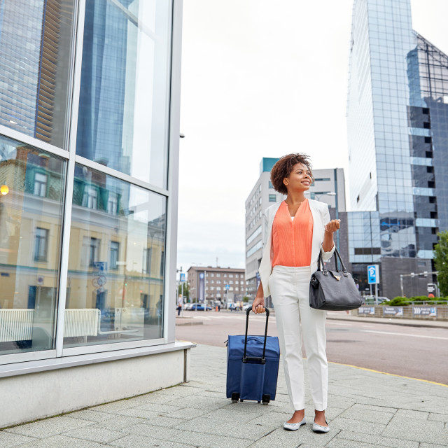 """""""happy young african woman with travel bag in city"""" stock image"""