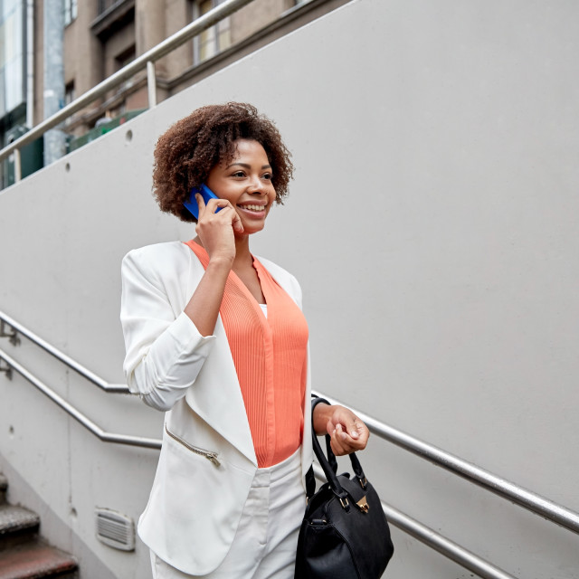 """""""happy african businesswoman calling on smartphone"""" stock image"""