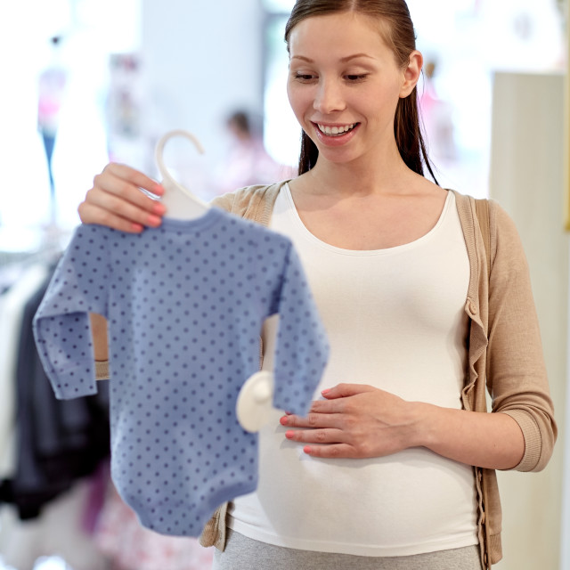 """""""happy pregnant woman shopping at clothing store"""" stock image"""