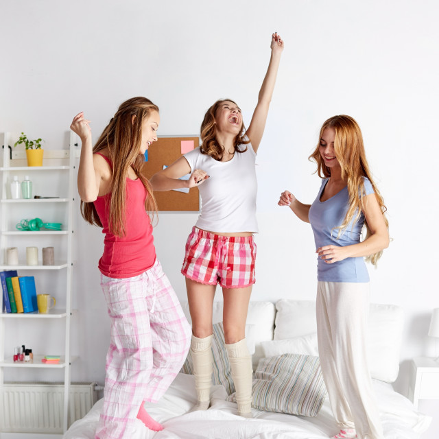 """""""happy friends or teen girls having fun at home"""" stock image"""