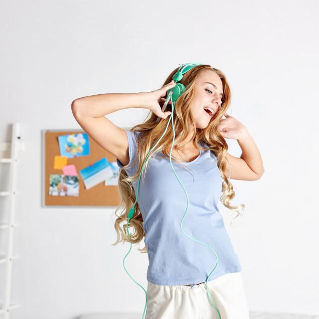 """happy woman in headphones ihaving fun at home"" stock image"