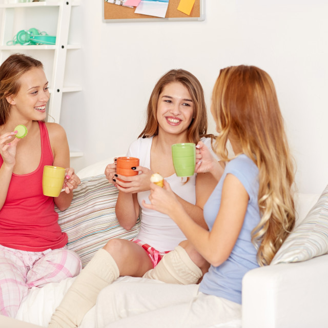 """""""happy young women drinking tea with sweets at home"""" stock image"""