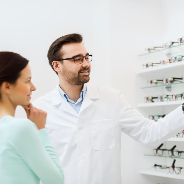 """""""woman and optician showing glasses at optics store"""" stock image"""