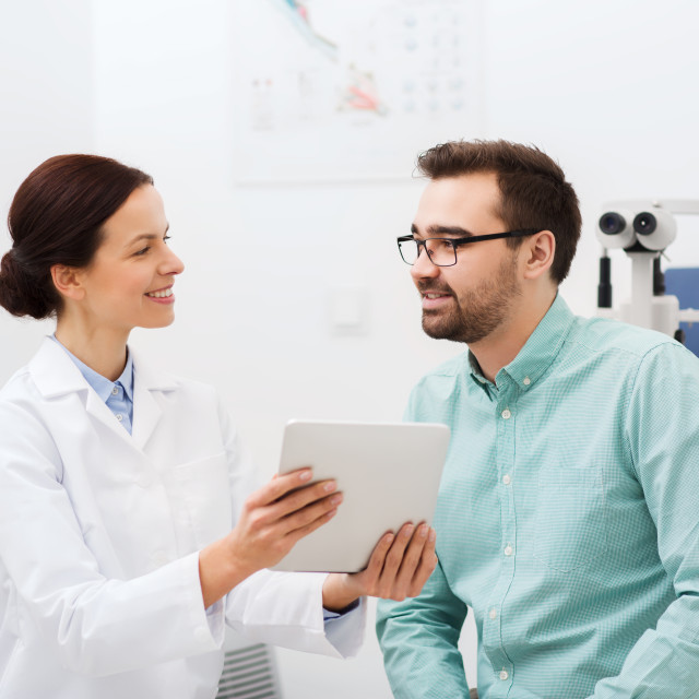 """""""optician with tablet pc and patient at eye clinic"""" stock image"""
