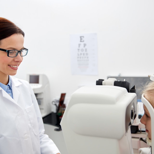 """""""optician with tonometer and patient at eye clinic"""" stock image"""