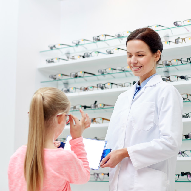 """optician and girl choosing glasses at optics store"" stock image"