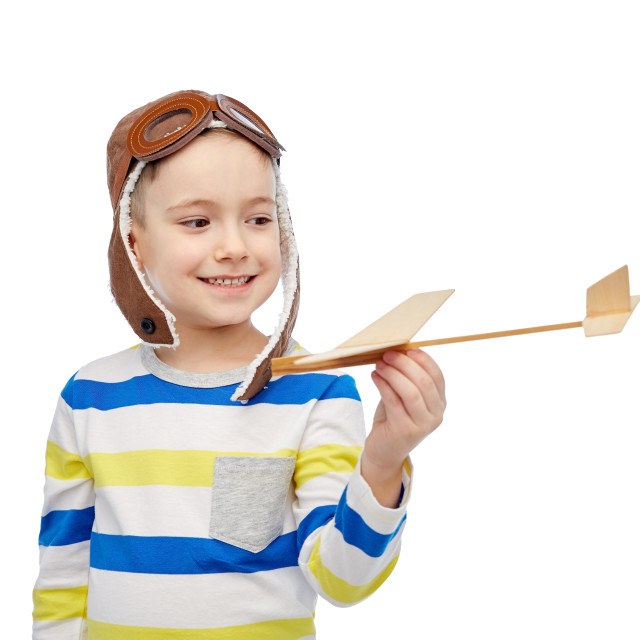 """""""happy little boy in aviator hat with airplane"""" stock image"""