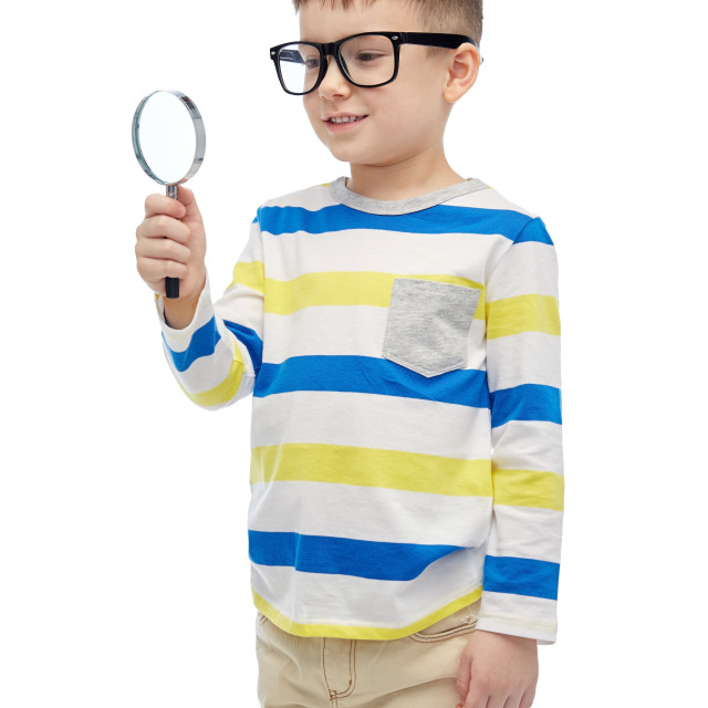 """""""little boy in eyeglasses with magnifying glass"""" stock image"""