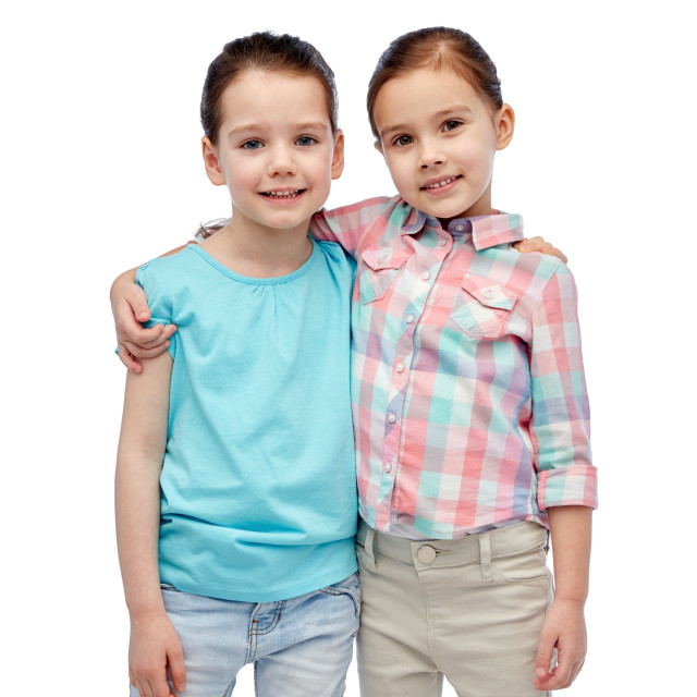 """happy smiling little girls hugging"" stock image"