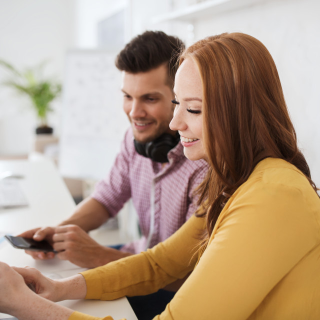 """""""happy creative team with smartphones at office"""" stock image"""