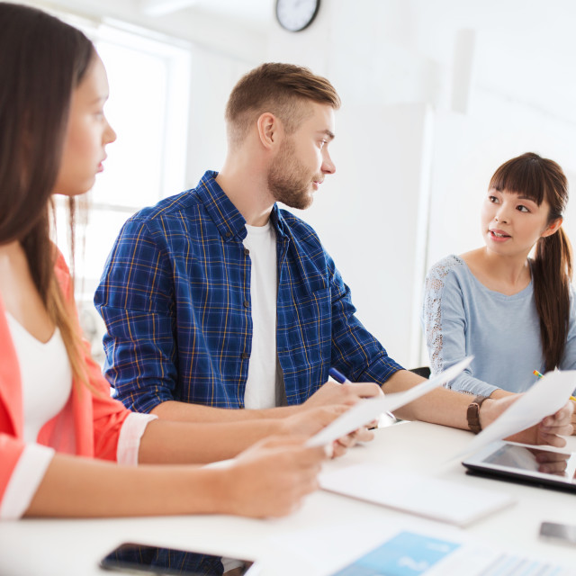 """""""happy creative team or students working at office"""" stock image"""
