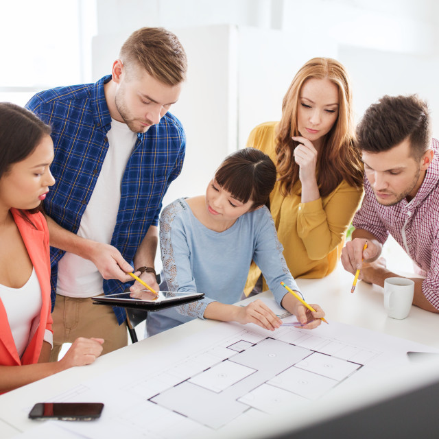 """""""creative team with blueprint working at office"""" stock image"""
