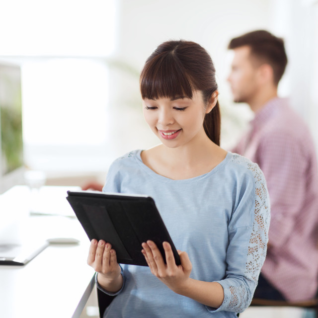 """""""happy creative female office worker with tablet pc"""" stock image"""