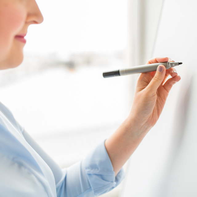 """""""close up of woman writing something on white board"""" stock image"""