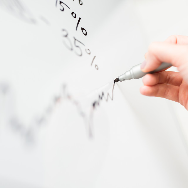 """""""close up of hand drawing graph on white board"""" stock image"""