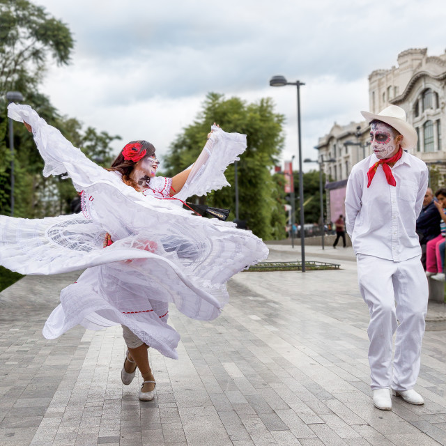 """A couple in traditional clothing dance outside Bellas Artes for Day of the Dead in Mexico City, Mexico"" stock image"