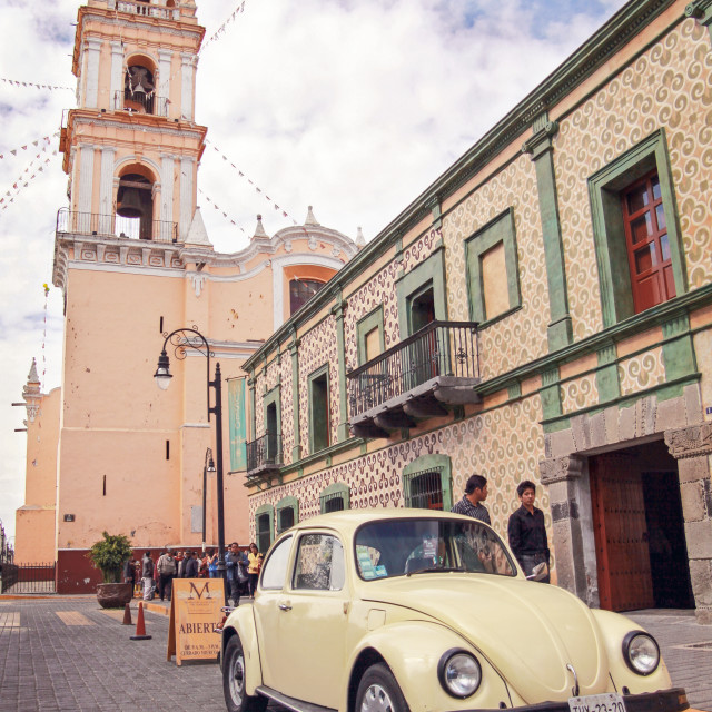 """a classic VW beetle parked outside a church in Puebla, Mexico"" stock image"