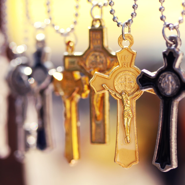 """""""Various crosses that are jewellery hanging from a market stand in mexico"""" stock image"""