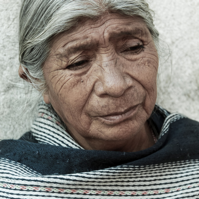 """An elderly indigenous lady sitting outside a building in mexico"" stock image"