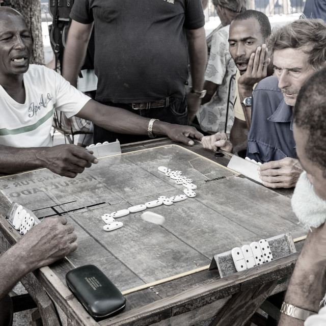 """Tensions are high as a group of gentlemen play dominoes in the street in havana, cuba"" stock image"