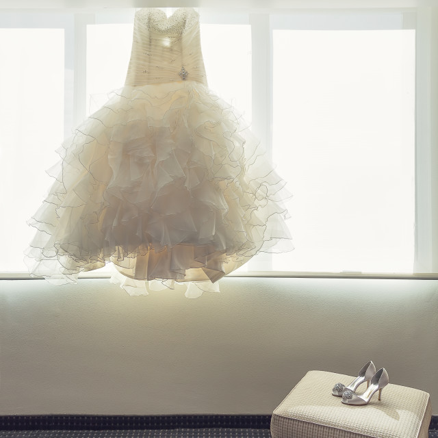 """""""Brides wedding dress and wedding shoes in a bedroom"""" stock image"""