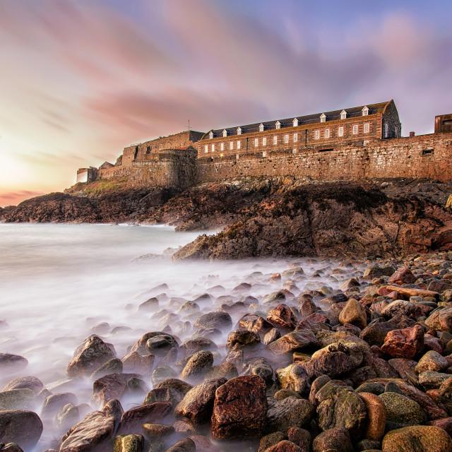 """Landscape photograph of Sunrise over Castle Cornet in Guernsey, United Kingdom"" stock image"