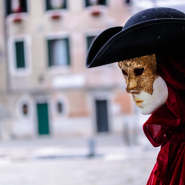 """""""a mannequin in a mask and red cloak outside a shop in venice in italy"""" stock image"""