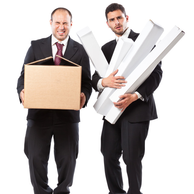 """Carryng the boxes"" stock image"