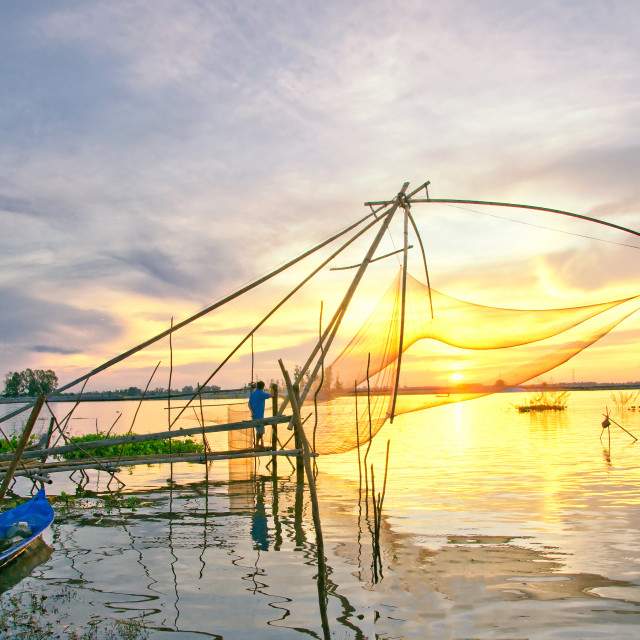 """Sunrise over fish net in Mekong Delta, An Giang, Vietnam"" stock image"